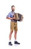 Άτομο στα παραδοσιακά βαυαρικά ενδύματα που παίζει το ακκορντέον Oktoberfe Στοκ εικόνα με δικαίωμα ελεύθερης χρήσης
