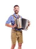 Άτομο στα παραδοσιακά βαυαρικά ενδύματα που παίζει το ακκορντέον Oktoberfe Στοκ φωτογραφία με δικαίωμα ελεύθερης χρήσης