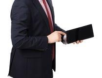 Άτομο στο κοστούμι με ένα PC ταμπλετών Στοκ φωτογραφία με δικαίωμα ελεύθερης χρήσης