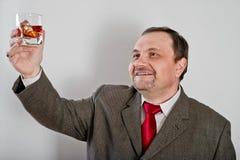 Άτομο στο κοστούμι με το γυαλί Στοκ Εικόνα