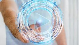 Άτομο σχετικά με την ψηφιακή συσκευή αναπαραγωγής πολυμέσων με το δάχτυλό του Στοκ φωτογραφία με δικαίωμα ελεύθερης χρήσης