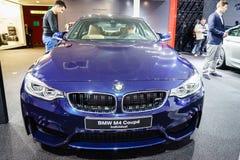 Άτομο της BMW M4 Coupe, έκθεση αυτοκινήτου Γενεύη 2015 Στοκ φωτογραφίες με δικαίωμα ελεύθερης χρήσης