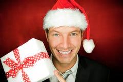 άτομο Χριστουγέννων παρόν Στοκ Εικόνες