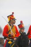 Άλογα γύρου ανδρών και γυναικών Στοκ εικόνα με δικαίωμα ελεύθερης χρήσης