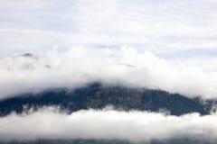Άλπεις στην ομίχλη Στοκ Φωτογραφίες