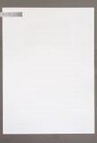 Έγγραφο σημειώσεων στο γκρίζο πλαίσιο Στοκ Εικόνες