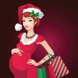 Έγκυες αγορές κοριτσιών Santa Χριστουγέννων Στοκ φωτογραφίες με δικαίωμα ελεύθερης χρήσης