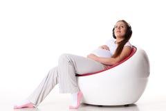 έγκυος γυναίκα ακουστικών Στοκ εικόνες με δικαίωμα ελεύθερης χρήσης