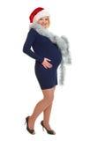Έγκυος γυναίκα διακοπών Χριστουγέννων στο καπέλο santa Στοκ εικόνα με δικαίωμα ελεύθερης χρήσης