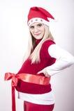 έγκυος γυναίκα με το τόξο καπέλων Χριστουγέννων στοκ εικόνα