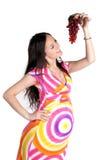 έγκυος γυναίκα σταφυλ&iot Στοκ φωτογραφία με δικαίωμα ελεύθερης χρήσης
