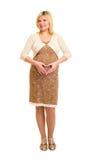 Έγκυος γυναίκα στο καφετί φόρεμα Στοκ Φωτογραφία