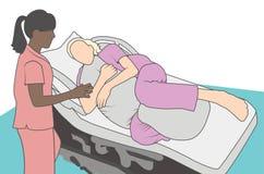 Έγκυος γυναίκα στο νοσοκομείο που χρησιμοποιεί το μαξιλάρι υποστήριξης εργασίας απεικόνιση αποθεμάτων