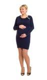 Έγκυος γυναίκα στο σκοτεινό φόρεμα Στοκ Φωτογραφίες
