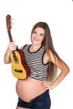 Έγκυο mom με το ukulele Στοκ φωτογραφία με δικαίωμα ελεύθερης χρήσης