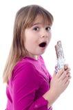 Έκπληκτος κάτω από την κατανάλωση σοκολάτας Στοκ εικόνα με δικαίωμα ελεύθερης χρήσης