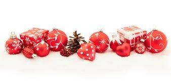 Έμβλημα υποβάθρου Χριστουγέννων στο κόκκινο στοκ φωτογραφίες