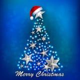 Έμβλημα Χριστουγέννων με το χριστουγεννιάτικο δέντρο στο μπλε υπόβαθρο Στοκ φωτογραφία με δικαίωμα ελεύθερης χρήσης