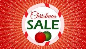 Έμβλημα πώλησης Χριστουγέννων με το κόκκινο υπόβαθρο Στοκ φωτογραφία με δικαίωμα ελεύθερης χρήσης