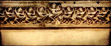Έμβλημα Grunge με τη γλυπτική, ναός Preah Khan, Angkor Wat, Cambo Στοκ φωτογραφία με δικαίωμα ελεύθερης χρήσης