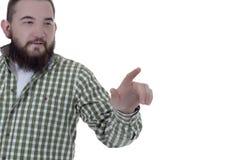 Ένας γενειοφόρος νεαρός άνδρας που δείχνει το δάχτυλό του Στοκ εικόνα με δικαίωμα ελεύθερης χρήσης