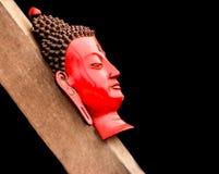 Ένας επικεφαλής πυροβολισμός του χεριού - ο γίνοντας Βούδας σε ένα ξύλο στο Κατμαντού Στοκ Εικόνες