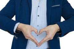 Ένας επιχειρηματίας παρουσιάζει σημάδι αγάπης Στοκ Φωτογραφίες