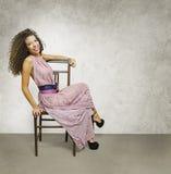 Ένας θηλυκός αριθμός για μια καρέκλα Στοκ φωτογραφία με δικαίωμα ελεύθερης χρήσης