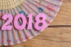 Ένας ρόδινος ανεμιστήρας χεριών με το 2018 για το κινεζικό νέο έτος Στοκ φωτογραφία με δικαίωμα ελεύθερης χρήσης