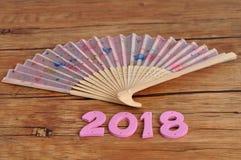Ένας ρόδινος ανεμιστήρας χεριών με το 2018 για το κινεζικό νέο έτος Στοκ εικόνα με δικαίωμα ελεύθερης χρήσης