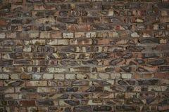 Ένας τοίχος του μμένου τούβλου Στοκ Φωτογραφίες