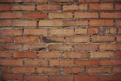 Ένας τοίχος του μμένου τούβλου Στοκ φωτογραφία με δικαίωμα ελεύθερης χρήσης