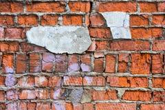 Ένας τοίχος των κόκκινων τούβλων Στοκ φωτογραφία με δικαίωμα ελεύθερης χρήσης