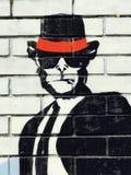 Ένας φανταχτερός πίθηκος με ένα μαύρο καπέλο & έναν δεσμό & το άσπρο πουκάμισο Στοκ Εικόνες