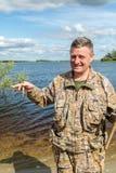Ένας ψαράς με μια σύλληψη Στοκ Εικόνες