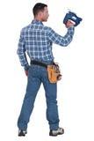 Ένας handyman με ένα τορνευτικό πριόνι. Στοκ Φωτογραφίες