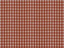 Ένα άνευ ραφής σχέδιο της ελεγμένης κόκκινης και άσπρης σύστασης υφάσματος στοκ εικόνες με δικαίωμα ελεύθερης χρήσης