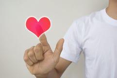 Ένα άτομο σχετικά με τα εικονικά κουμπιά μορφής καρδιών Στοκ εικόνες με δικαίωμα ελεύθερης χρήσης