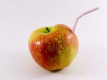 Ένα άχυρο ποτών της Apple Στοκ Φωτογραφίες