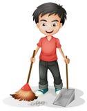 Ένα αγόρι που σκουπίζει το ρύπο απεικόνιση αποθεμάτων