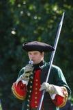 Ένα απόσπασμα των μελών της λέσχης των στρατιωτικών reenactors της φρουράς του φρουρίου (μουσείο πόλεων) Στοκ Εικόνα