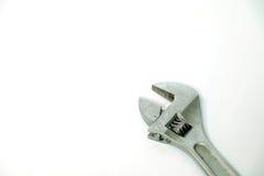 Ένα ασημένιο γαλλικό κλειδί για το σφιγγμένο αντικείμενο στο άσπρο υπόβαθρο Στοκ Εικόνες