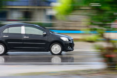 Ένα αυτοκίνητο με τη θαμπάδα κινήσεων Στοκ Εικόνες