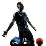 Ένα αφρικανικό άτομο ποδοσφαιριστών απομόνωσε το άσπρο υπόβαθρο silhouet Στοκ Φωτογραφίες