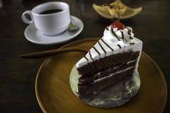 Ένα εύγευστο κέικ με έναν καφέ και την ατζέντα Στοκ Φωτογραφίες