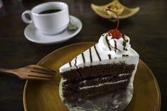 Ένα εύγευστο κέικ με έναν καφέ και την ατζέντα Στοκ Φωτογραφία