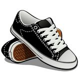 Ένα ζευγάρι των πάνινων παπουτσιών με τις άσπρες δαντέλλες που απομονώνεται στο άσπρο υπόβαθρο Κλασικά αθλητικά παπούτσια επίσης  απεικόνιση αποθεμάτων