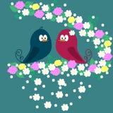 Ένα ζευγάρι των πουλιών σε έναν κλάδο με τα λουλούδια Στοκ εικόνες με δικαίωμα ελεύθερης χρήσης