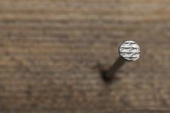 Ένα καρφί σε μια ξύλινη σανίδα Στοκ Εικόνες