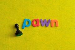 Ένα κομμάτι σκακιού ενέχυρων με το ενέχυρο λέξης Στοκ Φωτογραφίες